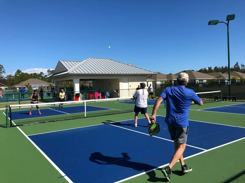 residents playing tennis