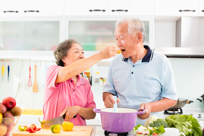 asian couple cooking
